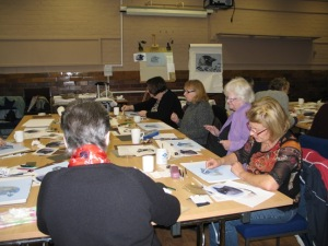 Art Group members absorbed in drawing a bird study